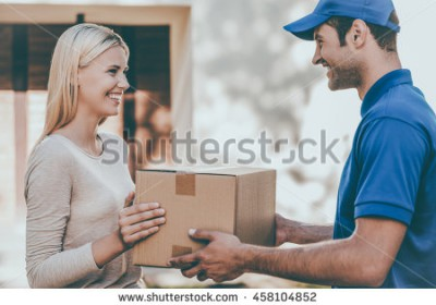 stock-photo-here-you-go-side-view-of-happy-young-delivery-man-giving-a-cardboard-box-to-young-woman-while-458104852